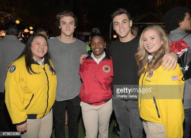 YouTubers Ethan Dolan and Grayson Dolan with City Year AmeriCorps member at City Year Los Angeles Spring Break on May 6 2017 in Los Angeles California
