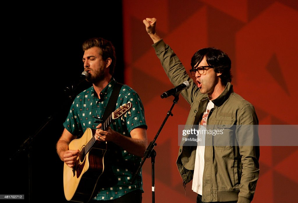 YouTubers Rhett James Maclaughlan (L) and Charles Lincoln 'Link' Neal of 'Rhett and Link' perform at #VidCon at Anaheim Convention Center on July 23, 2015 in Anaheim, California.