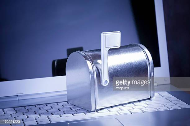 you've got mail. miniature silver mailbox on white laptop. - e mail inbox stock pictures, royalty-free photos & images