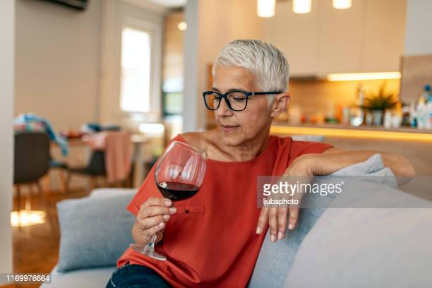 you've gotta spoil yourself every now and then - alcohol abuse stock pictures, royalty-free photos & images