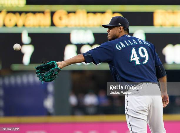 Yovani Gallardo of the Seattle Mariners gets a new ball after giving up a home run to Tim Beckham of the Baltimore Orioles on the first pitch of the...