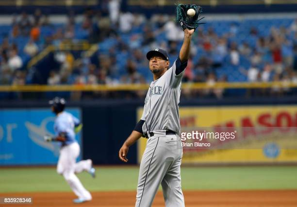 Yovani Gallardo of the Seattle Mariners reacts on the mound after allowing a tworun home run to Adeiny Hechavarria of the Tampa Bay Rays during the...