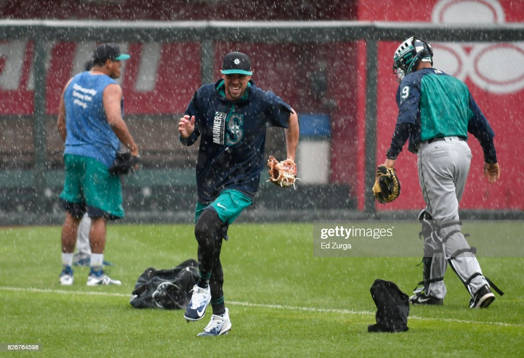 Yovani Gallardo #49 of the Seattle Mariners runs off the field as rain comes down at Kauffman Stadium prior to a game against the Kansas City Royals on August 5, 2017 in Kansas City, Missouri. The game was postponed and will be made up as a doubleheader tomorrow.