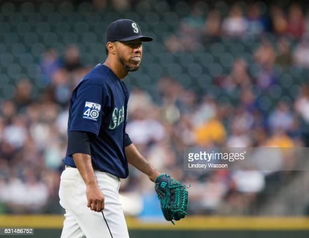 Yovani Gallardo of the Seattle Mariners walks off the field after giving up six runs including a grand slam to the Baltimore Orioles at Safeco Field...