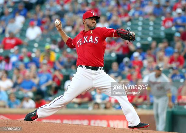 Yovani Gallardo of the Texas Rangers delivers a pitch in the first inning of a baseball game agaisnt the Minnesota Twins at Globe Life Park in...