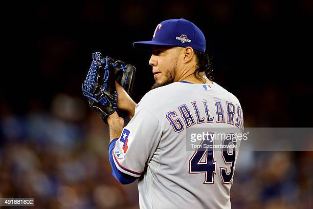 Yovani Gallardo of the Texas Rangers looks to throw a pitch against the Toronto Blue Jays during game one of the American League Division Series at...