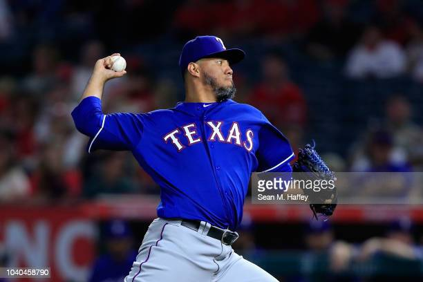 Yovani Gallardo of the Texas Rangers pitches during the first inning of a game against the Los Angeles Angels of Anaheim at Angel Stadium on...