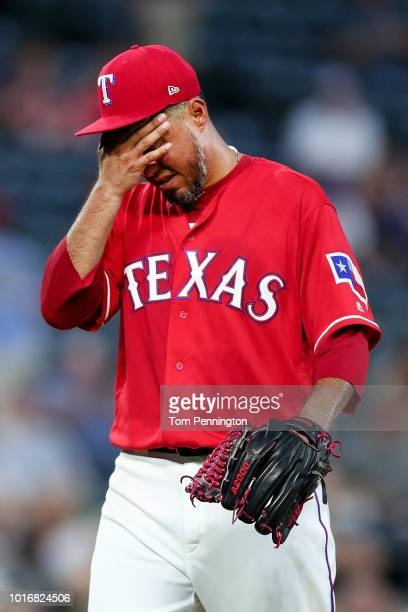 Yovani Gallardo of the Texas Rangers reacts after being pulled from the game against the Arizona Diamondbacks in the top of the fourth inning at...