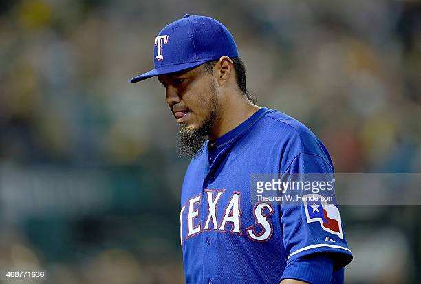 Yovani Gallardo of the Texas Rangers walks back to the dugout after he was taken out of the game in the bottom of the fifth inning against the...