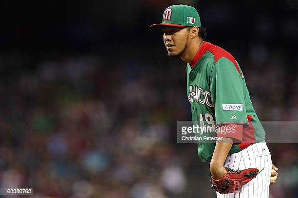 Yovani Gallardo#49 of Mexico gets set to throw a pitch against the United States during the World Baseball Classic First Round Group D game at Chase...