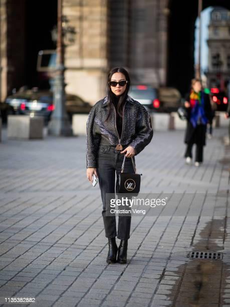 Yoyo Cai is seen wearing black leather jacket denim jeans bag outside Louis Vuitton during Paris Fashion Week Womenswear Fall/Winter 2019/2020 on...
