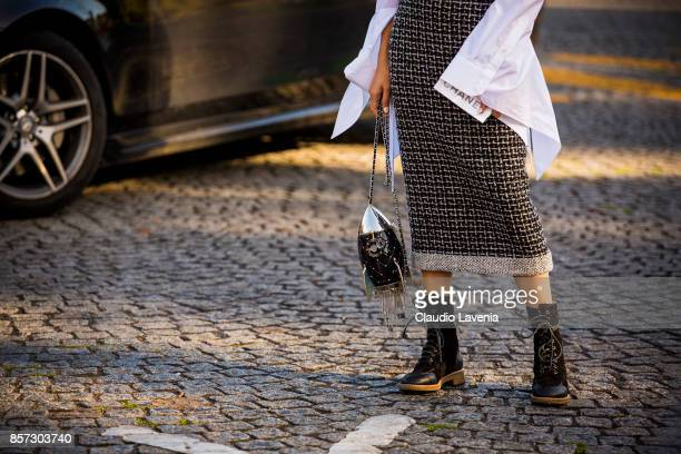 Yoyo Cao bag detail is seen before the Chanel show during Paris Fashion Week Womenswear SS18 on October 3 2017 in Paris France