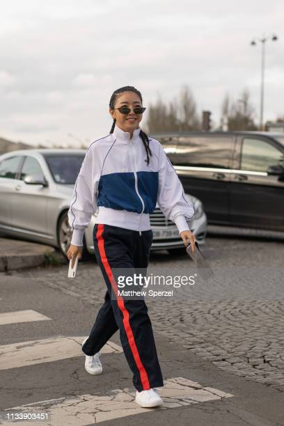 Yoyo Cao is seen on the street attending Lacoste during Paris Fashion Week AW19 wearing Lacoste on March 05 2019 in Paris France