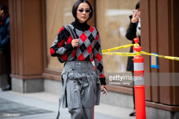 Yoyo Cao is seen wearing checkered jumper grey pants outside Michael Kors during New York Fashion Week Fall / Winter 2020 on February 12 2020 in New...