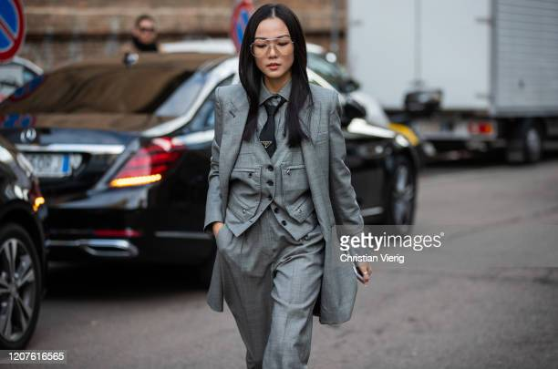 Yoyo Cao is seen wearing Prada tie grey blazer suit pants outside Max Mara during Milan Fashion Week Fall/Winter 20202021 on February 20 2020 in...