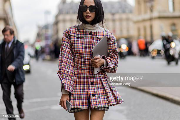 Yoyo Cao is wearing a plaid jacket and black boots outside Dior during the Paris Fashion Week Womenswear Fall/Winter 2016/2017 on March 4 2016 in...