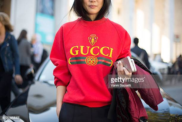Yoyo Cao poses wearing a Gucci sweater after the Sacai show at the Palais de Tokyo during Paris Fashion Week Womenswear SS17 on October 3 2016 in...