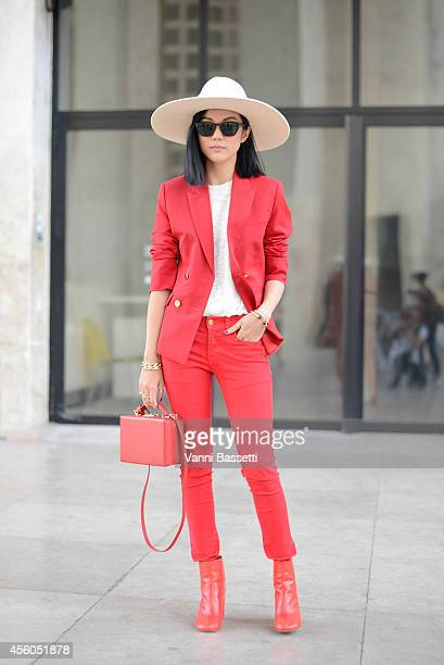 Yoyo Cao poses wearing a Mark Cross bag and Margiela shoes on September 24 2014 in Paris France