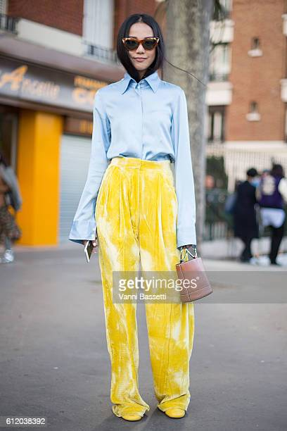 Yoyo Cao poses wearing Celine after the Celine show at the Tennis Club de Paris during Paris Fashion Week Womenswear SS17 on October 2 2016 in Paris...