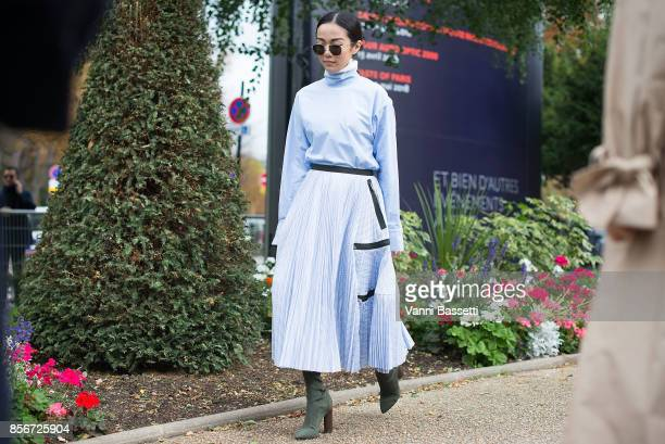 Yoyo Cao poses wearing Sacai after the Sacai show at the Grand Palais during Paris Fashion Week Womenswear SS18 on October 2 2017 in Paris France