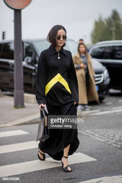 Yoyo Cao seen outside Celine during Paris Fashion Week Spring/Summer 2018 on October 1 2017 in Paris France
