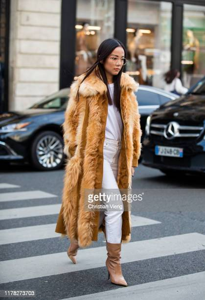Yoyo Cao seen wearing beige brown fur coat white pants shirt boots outside Stella McCartney during Paris Fashion Week Womenswear Spring Summer 2020...