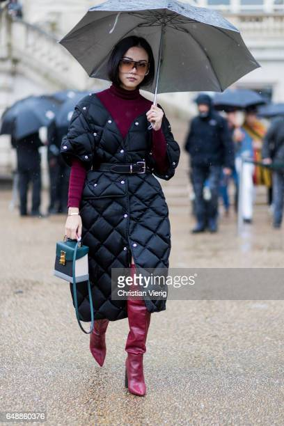 Yoyo Cao wearing a black puffy coat turtleneck overknees outside Stella McCartney on March 6 2017 in Paris France