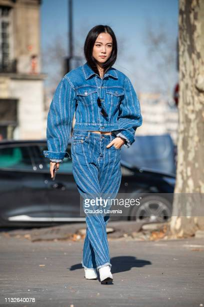 Yoyo Cao wearing a blue denim jacket with matching jeans and white shoes is seen outside Mugler on Day 3 Paris Fashion Week Autumn/Winter 2019/20 on...