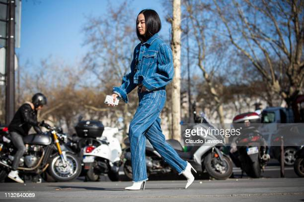 Yoyo Cao, wearing a blue denim jacket with matching jeans and white shoes, is seen outside Mugler on Day 3 Paris Fashion Week Autumn/Winter 2019/20...