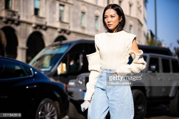 Yoyo Cao, wearing a cream decorated sweater and blue jeans, is seen outside Philosophy di Lorenzo Serafini show, during Milan Fashion Week...