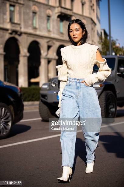 Yoyo Cao, wearing a cream decorated sweater, blue jeans and white heels, is seen outside Philosophy di Lorenzo Serafini show, during Milan Fashion...