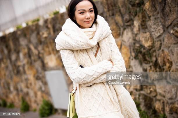 Yoyo Cao, wearing a cream knitted midi dress with matching cardigan, is seen outside Loewe, during Paris Fashion Week - Womenswear Fall/Winter...