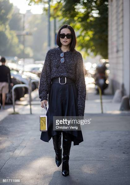 Yoyo Cao: Yoyo Cao Wearing A Grey Knit, Navy Midi Skirt With Belt