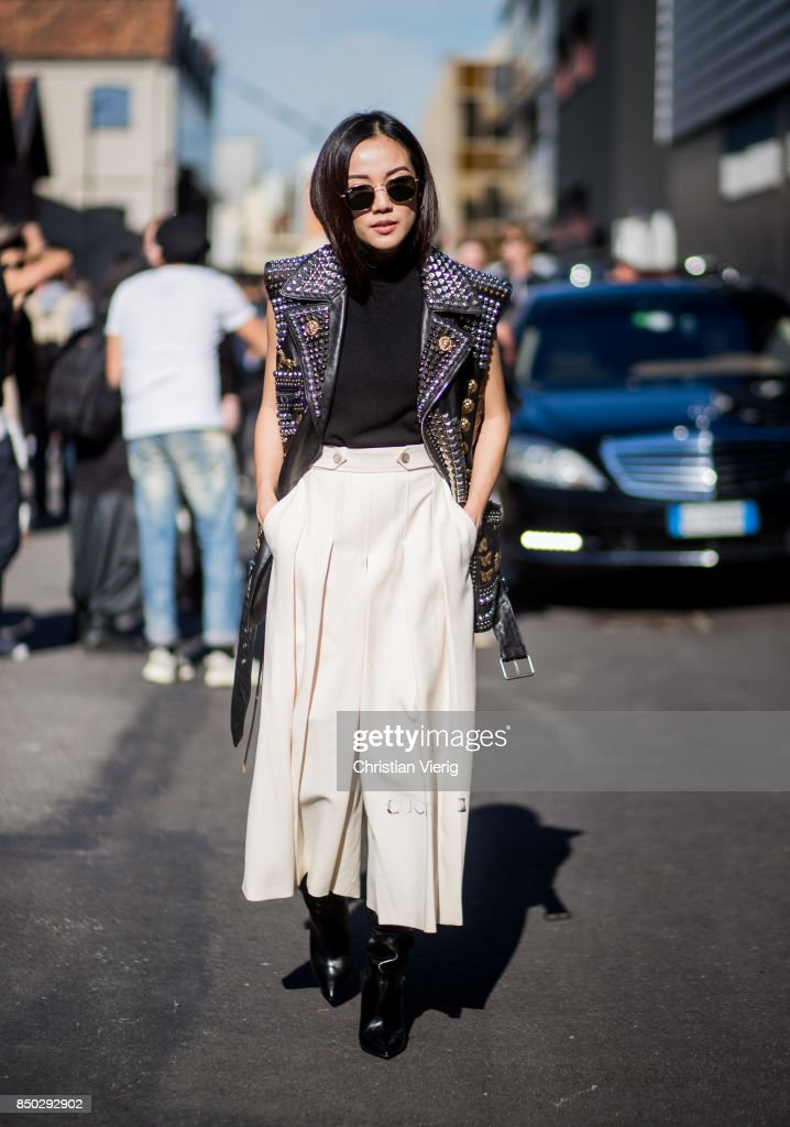 Yoyo Cao wearing a leather vest, maxi skirt is seen outside Gucci during Milan Fashion Week Spring/Summer 2018 on September 20, 2017 in Milan, Italy.