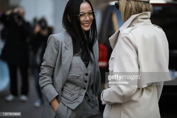 Yoyo Cao wearing a Max Mara look and Prada tie and Xenia Adonts outside Max Mara during Milan Fashion Week Fall/Winter 20202021 on February 19 2020...