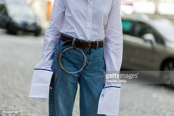 Yoyo Cao wearing a white blouse with oversized sleeves and denim jeans outside Balmain on September 29 2016 in Paris France