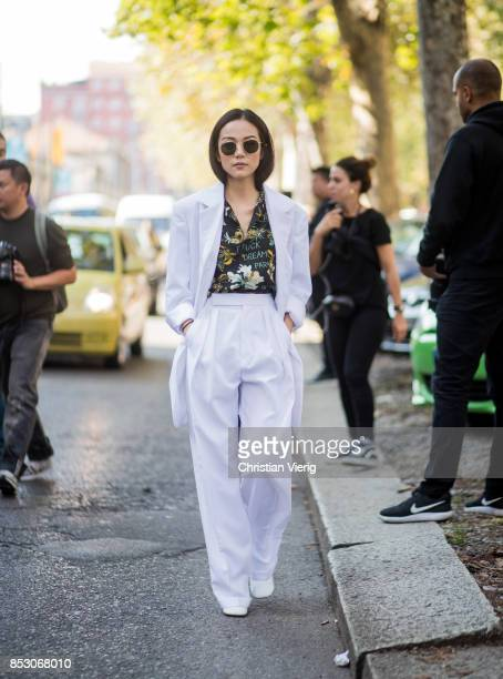 Yoyo Cao wearing a white suit button shirt with floral print is seen outside Marni during Milan Fashion Week Spring/Summer 2018 on September 24 2017...
