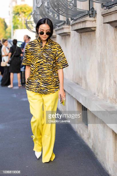 Yoyo Cao wearing a yellow trousers and animalier shirt is seen in the streets of Milano before the Prada show during Milan Fashion Week Spring/Summer...