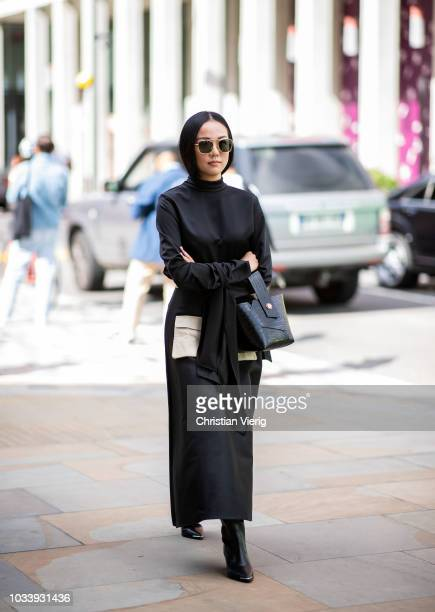 Yoyo Cao wearing black maxi dress is seen outside Ports 1961 during London Fashion Week September 2018 on September 15 2018 in London England
