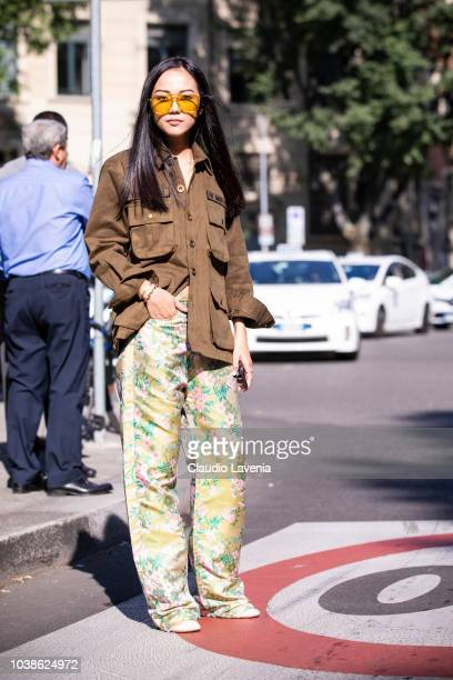 Yoyo Cao wearing brown jacket and floral pants is seen before the Giorgio Armani show during Milan Fashion Week Spring/Summer 2019 on September 23...