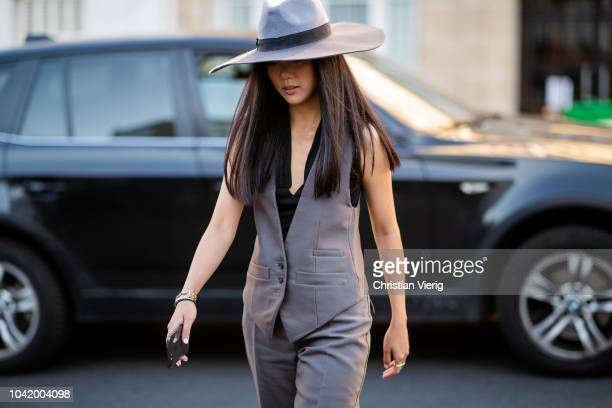 Yoyo Cao wearing hat, grey vest, grey pants is seen outside Chloe during Paris Fashion Week Womenswear Spring/Summer 2019 on September 27, 2018 in...