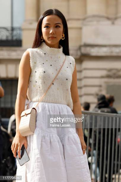 Yoyo Cao wearing knit vest and white midit skirt outside the Elie Saab show during Womenswear Spring/Summer 2020 show Paris Fashion Week on September...