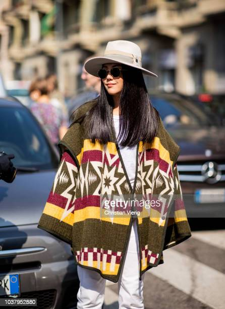 Yoyo Cao wearing poncho with hat is seen outside Etro during Milan Fashion Week Spring/Summer 2019 on September 21, 2018 in Milan, Italy.