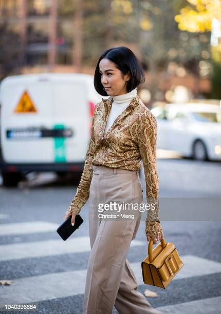 Yoyo Cao wearing shirt with snake print is seen outside Koche during Paris Fashion Week Womenswear Spring/Summer 2019 on September 25 2018 in Paris...