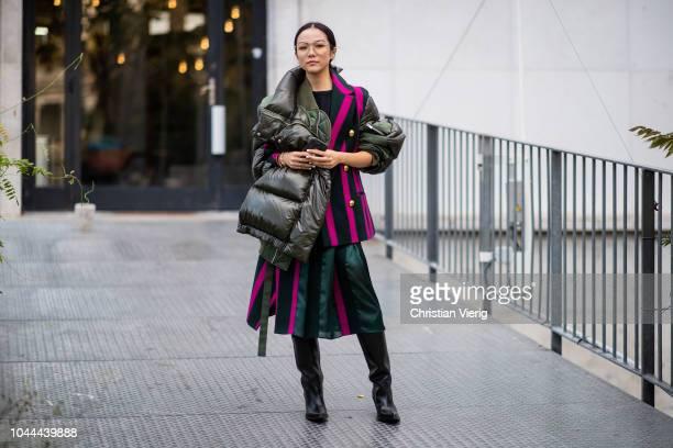 Yoyo Cao wearing striped blazer puffer jacket is seen outside Sacai during Paris Fashion Week Womenswear Spring/Summer 2019 on October 1 2018 in...