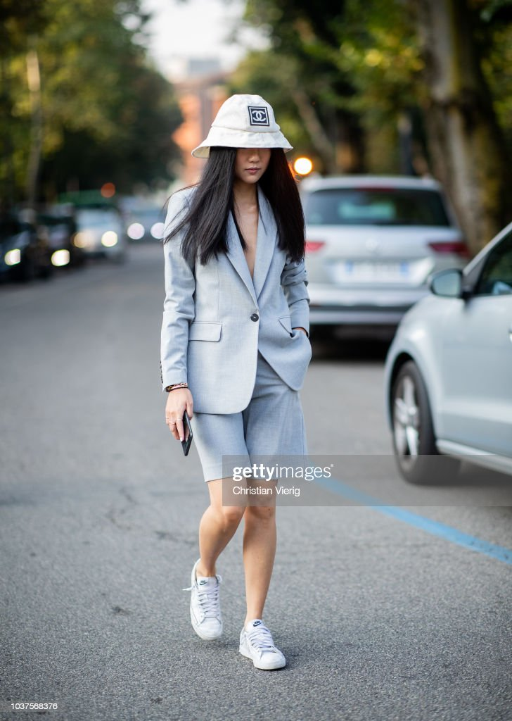 8fc0d6d5e Yoyo Cao wearing white Chanel bucket hat, cropped shorts, suit is ...