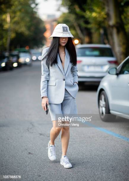 Yoyo Cao wearing white Chanel bucket hat cropped shorts suit is seen outside Tods during Milan Fashion Week Spring/Summer 2019 on September 21 2018...
