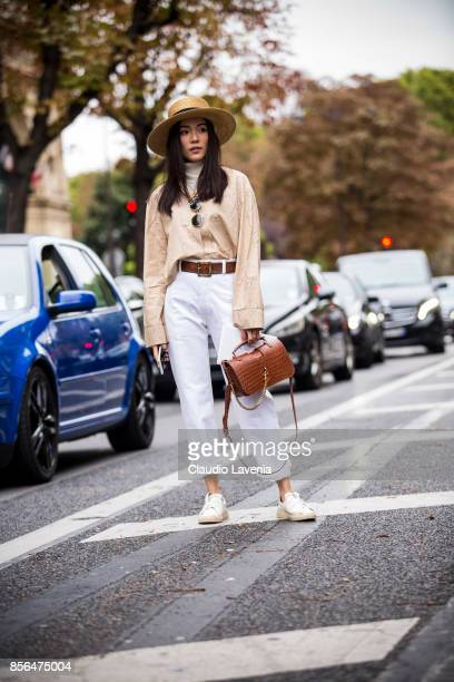 Yoyo Cao wearing white pants and a straw hat is seen before the Valentino show during Paris Fashion Week Womenswear SS18 on October 1 2017 in Paris...