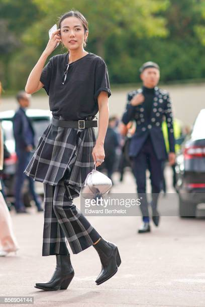 Yoyo Cao wears a black tshirt tartan pants outside Hermes during Paris Fashion Week Womenswear Spring/Summer 2018 on October 2 2017 in Paris France
