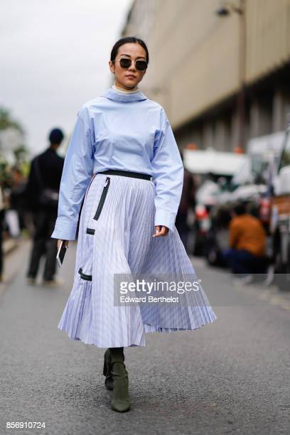 Yoyo Cao wears a blue flare top pleated skirt outside Giambattista Valli during Paris Fashion Week Womenswear Spring/Summer 2018 on October 2 2017 in...